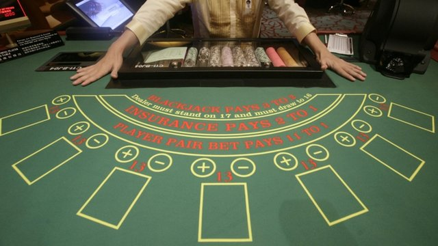 A croupier at a Blackjack table