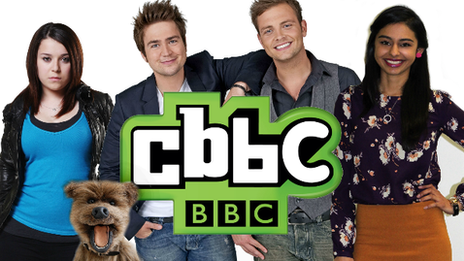 CBBC presenters next to the CBBC logo