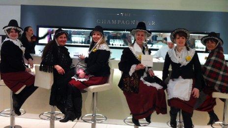 The group inside Harrods' champagne bar