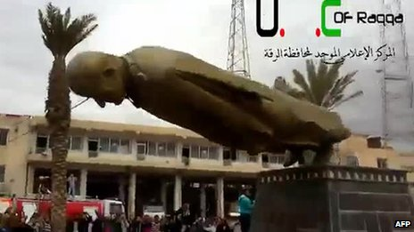 Image grab of YouTube footage purportedly showing Syrian opposition protesters destroying a statue of ex-President Hafez Assad in Raqqa on 4/3/13