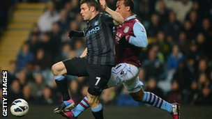 James Milner of Manchester City (left)and Aston Villa's Gabriel Agbonlahor