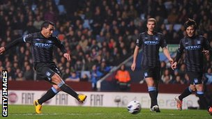 Carlos Tevez (left) scores for Manchester City