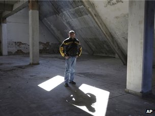 A man stands inside an abandoned factory in Drvar (4 March 2013)