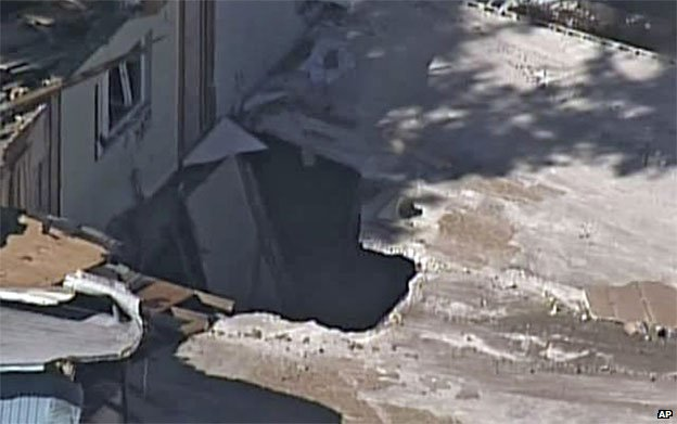The sinkhole revealed as the house is demolished