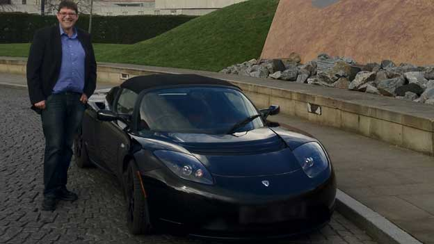 Andrew Bissell drives a Tesla roadster