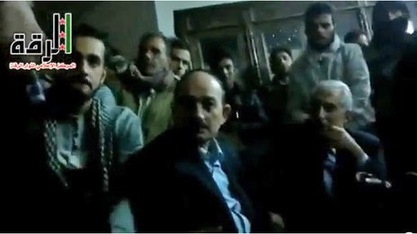Frame from amateur video purported to show Raqqa governor Hassan Jalili (right) alongside provincial Baath party chief Suleiman Suleiman