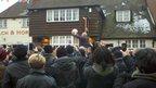 John Tomkinson throws the ball into the crowd