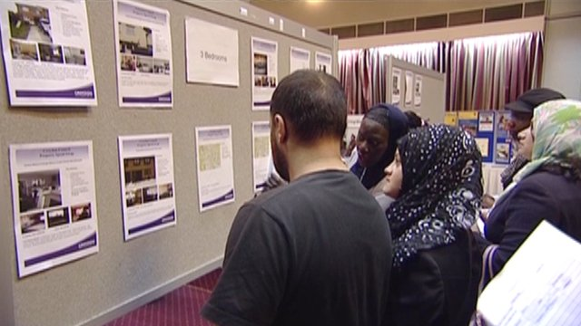 Residents looking at housing adverts