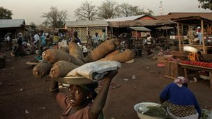 A Ghanaian with yams in Tamale market, Ghana (Archive shot 2008)