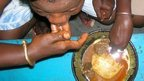 People eating a meal with fufu (Archive shot)