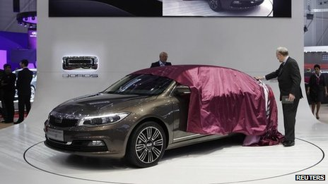Qoros bosses unveil the new Qoros 3 sedan car