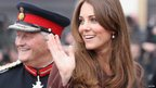 Duchess of Cambridge waving with Lord-Lieutenant of Lincolnshire Tony Worth behind