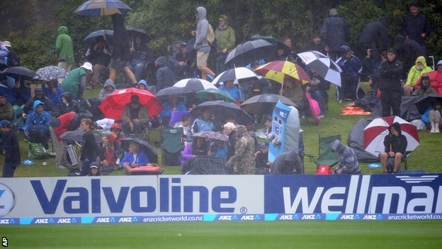 Spectators wait in vain for the rain to stop in Dunedin