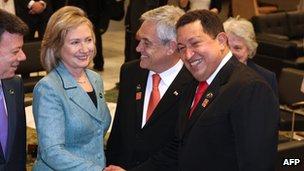 Hillary Clinton shakes hands with Hugo Chavez