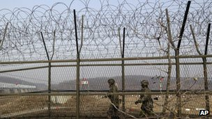 South Korean army soldiers patrol along a barbed-wire fence at the Imjingak Pavilion near the border village of Panmunjom, which has separated the two Koreas since the Korean War, in Paju, north of Seoul, South Korea, 6 March 2013