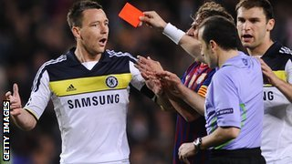 Referer Cuneyt Cakir sends off Chelsea&#039;s John Terry against Barcelona in 2012