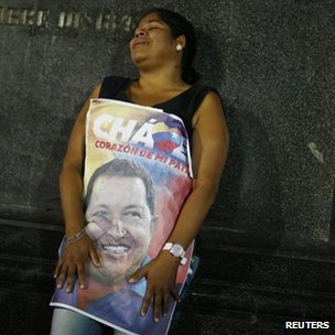 A supporter of Venezuela's President Hugo Chavez reacts to the announcement of his death in Caracas on Tuesday