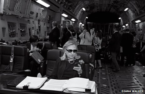 Secretary of State Hillary Clinton checks her smartphone as her plane departs from Malta, bound for Tripoli, Libya, October 18 2011.  (Diana H. Walker Photographic Archive Dolph Briscoe Center for American History The University of Texas at Austin)