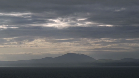 The mountains of Snowdonia across the sea from Ardudwy