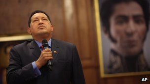 Hugo Chavez in front of a portrait of Simon Bolivar, 9 October 2012
