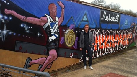 Greg Rutherford with mural at Milton Keynes Athletics Club
