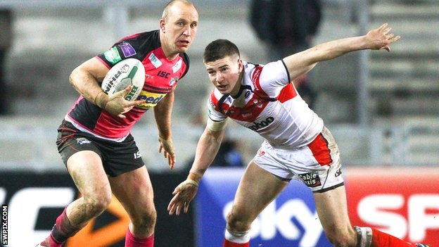 St Helens centre Mark Percival (right) in action against Leeds Rhinos