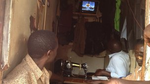 Watching results come in at a shop in Kibera