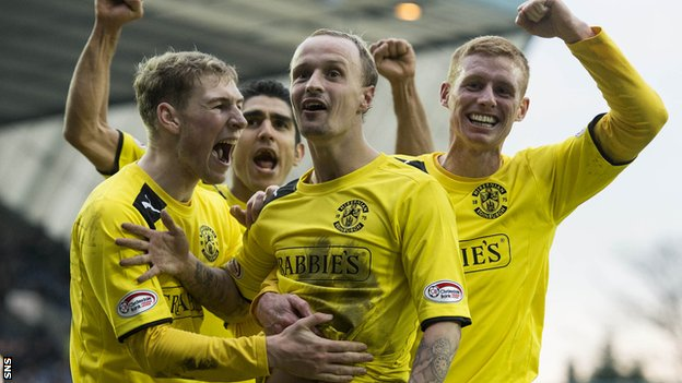 Hibernian beat Kilmarnock 4-2 to reach the last four in the Scottish Cup.