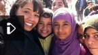 Leah with refugee children in Zaatari refugee camp