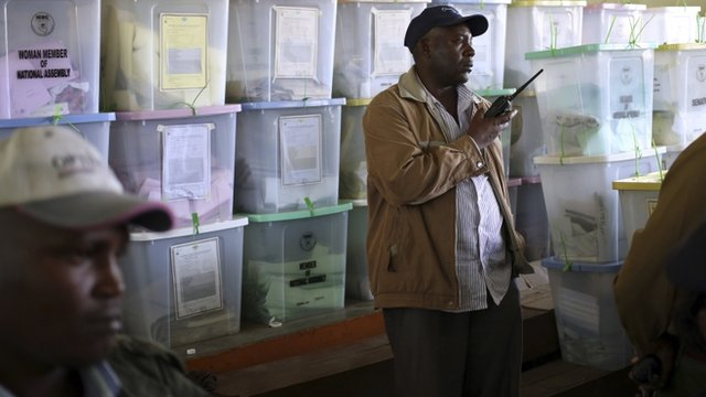 A policeman stands in front of ballot boxes in a tallying centre in Kenya