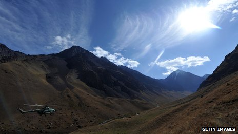 A helicopter approaches Vladimir Putin Peak in Kyrgyzstan