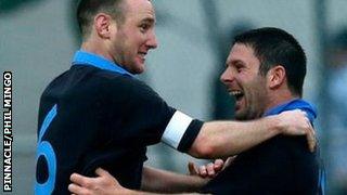 Luke Watson congratulates Jersey scorer Jack Cannon
