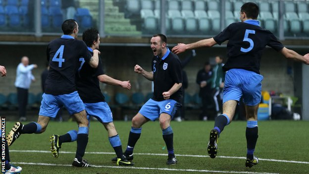 Jersey captain Luke Watson celebrates Jamie Savory's goal