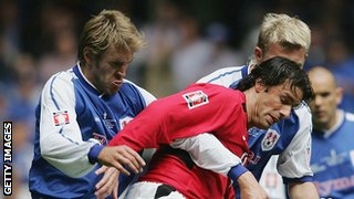 Matt Lawrence tussles with Manchester United's Ruud van Nistelrooy