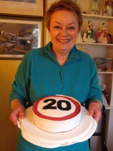 Irene Ralph with a '20' cake