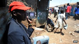 A man listens to a radio in Kenya on 5 March 2013