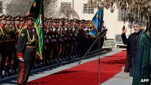 President Hamid Karzai inspects a guard of honour after his arrival for the opening session of Parliament in Kabul on 6 March 2013