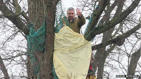 Protester in tree