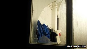The broken window at the Woking dressing room