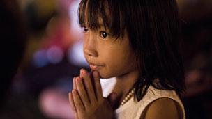 Cambodian child mourning King Sihanouk