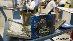 The damaged battery case from a fire aboard a Japan Airlines (JAL) Boeing 787 Dreamliner airplane at Logan International Airport in Boston