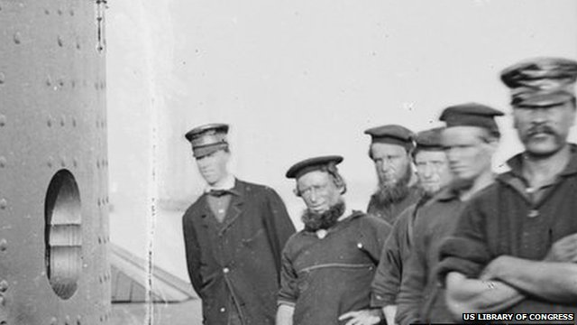 Welsh-born fireman Robert Williams (far right) is pictured with the ship's crew