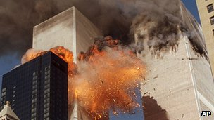 Smoke billows from one of the towers of the World Trade Center (11 September 2001)