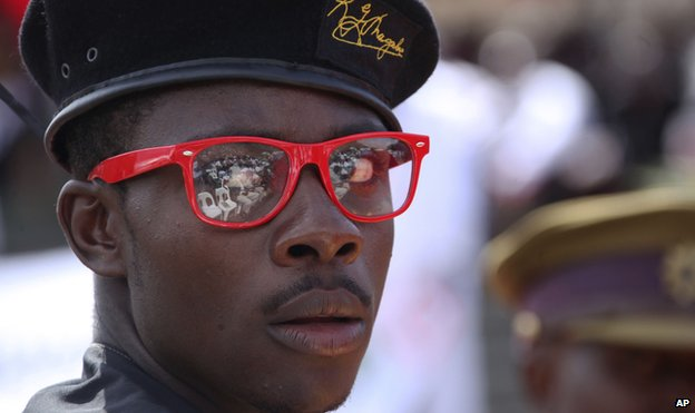 A man wearing a President Robert Mugabe designer label beret - 21 January 2013