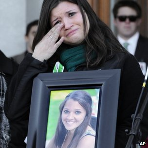Heather Cronk carries a photograph of her cousin, Victoria Soto, who died in Sandy Hook massacre