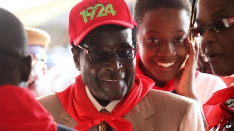 Zimbabwean President Robert Mugabe during celebrations to mark his 89th birthday in Bindura on 2 March 2013 - wearing a R G Mugabe label cap with the year 1924 printed on it - the year of his birth