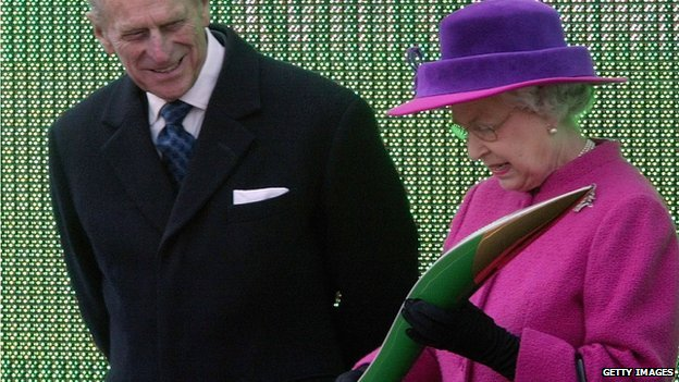 The Queen and the Duke of Edinburgh examine the baton at the launch of the relay for the Melbourne 2006 games