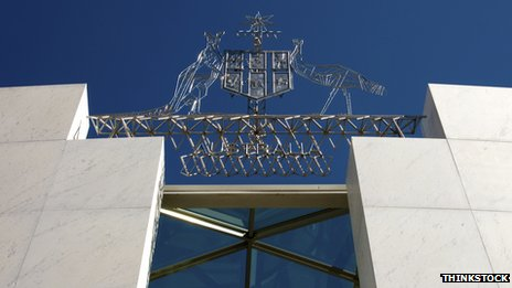 The coat of arms above the entrance to Canberra&#039;s Parliament House