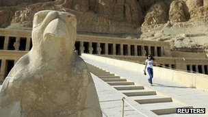 A tourist walks down the main corridor of the Temple of Hatshepsut, in Luxor, February 27, 2013