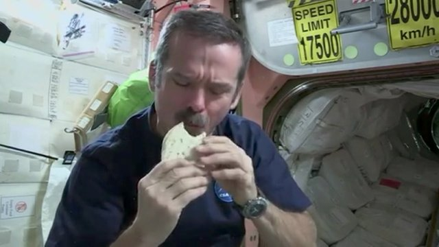 Chris Hadfield eating his space sandwich